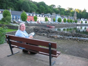Me, working on Blue Belle of Scotland on my Alphasmart in Tobermory, Isle of Mull, Scotland, where the book is set.