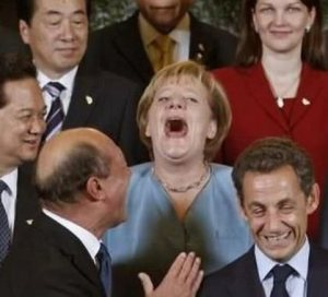 AngelaMerkel laughing in group