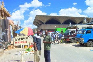 Mr. Iddi and Bashir - unique Kariakoo Market structure in background